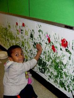 Handprints make a garden mural.  Use as an extension with the book In the Tall Tall Grass.