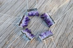 *These amazing raw amethyst slices have been hand picked for the most vibrant colors, unique crystal formations, and highest sparkle throughout. The pendants have a rough, unpolished edge at the bottom of the pendant to showcase the crystals true, natural beauty. *Great gift for a February birthday, as amethyst is the birthstone. *Each pendant is unique, and variances in color and size it typical of this type of stone. *The stones slices range from 25mm (1) to 38mm (1.5) across and average…