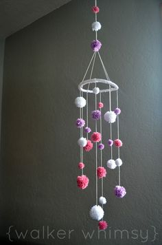 Great way for CrochetHolics to use up all that scrap yarn! {walker whimsy}: Pom Pom Mobile