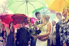 Keep your guests dry on your wedding day with colorful umbrellas.