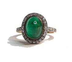 A rare jewelled Fabergé ring, an oval cabochon emerald encircled by cushion cut diamonds, the shoulders of the reeded gold shank each set with four diamonds, mounted on a pierced gallery. Workmaster: Alfred Thielemann, St. Petersburg, circa 1900. Rings are the rarest forms of Fabergé jewellery. Very few have survived and been identified because Fabergé hallmarked rings on the outside of the shank and the marks wear away over time.