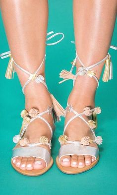 Lace-Up sandals with a metallic nail polish pedicure