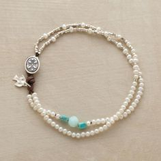 A focal point of turquoise and blue quartz trains the eye on strands of cultured pearls and sterling silver. Button and leather loop closure. Handmade....