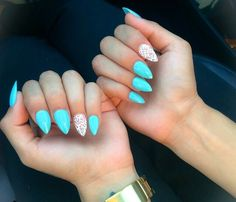 Bright blue almond shape nails a/ white lace effect