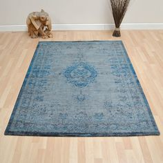 Louis de poortere fading world rugs 8255 grey turquoise buy online from the rug seller uk