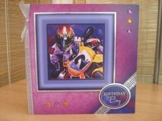 """This manly card measures 8"""" x 8"""" in size and comes with a white envelope and protected in a cello bag. The topper features a motorbike, which has silver foiling around the edge, has been raised to give dimension. The sentiment reads """"Birthday Boy"""". A silver ribbon, bow and gems have been added to decorate. The inside has been left blank for your own personal message. http://www.makesellbuy.com/products/view/13629928497/handmade-birthday-card-mens-birthday-boy-motorbike"""