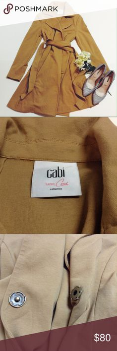 HP✨ Cabi love Carol collection trench coat Camel color stretchy trench coat by Cabi love Carol collection with button snap front and sleeves. There is a small scratch pictured above. Size small CAbi Jackets & Coats Trench Coats