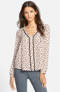 Free shipping and returns on ASTR V-Neck Print Top at Nordstrom.com. Subtle open-stitch insets add dimension to a printed long-sleeve top accented by Y-shaped trim and finished with a flattering inverted back pleat.