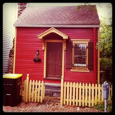 """Featured as one of Savannah """"tiny"""" houses and painted in the red color often used on 18th Century wood homes in Savannah, 536 East State Street was built for John Dorsett in 1845. It had originally been located on Hull Street but was moved to this location in order to save it."""