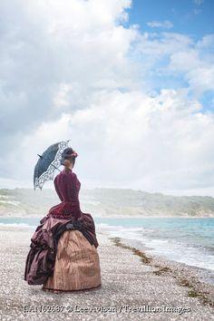 © Lee Avison / Trevillion Images - victorian-woman-on-beach-with-parasol