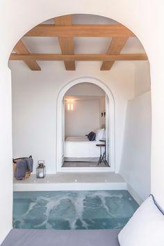 Porto Fira Suites, Santorini, Greece. 13 room resort each with their own veranda, envisioned by Interior Design Laboratorium