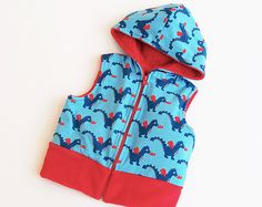 ★ This is a super cute and easy hooded DRAGON VEST!! For empowered KIDS from 3 to 10 years ★ It's also available for Babies newborn up to 2 years here: https://www.etsy.com/listing/113227478/dragon-vest-for-baby-hooded-easy-knit   Fully and easily lined, it's ideal for all seasons. The style of the contrasting hem band and the armholes brings out the visible lining on the outside. The hem band is at hipline.  No serger required,it can also be made with woven fabrics and knit hem band   ALL…