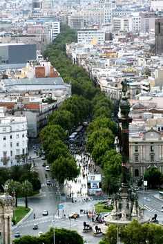 Las Ramblas - Barcelona, Spain. This grabbed my attention because of the contrast between the built environment and green space. The rows of trees break up the city and create a divide. It almost seems like the trees are pushing up through the concrete like an invasive specie, while in reality the built environment is invading on nature.