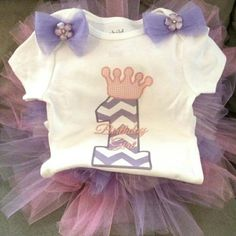 Custom made, customer requested, princess first birthday tutu outfit. #custommade for a client's #babygirl #firstbirthday #birthdaygirl #tutu and #onesie #handmade by Sabrina Rueck & graphic art by Becky Davino of Little Red Wagon Creations, LLC : www.lrwcreations.com #craftsforsale #craftygirl #livetocraft #myhobbyistakingovermylife #babycouture #baby #birthday #pink #purple #princess #fashionista #girlie #babyshower