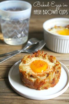 Bake eggs in hash brown nests for an easy on-the-go breakfast.  Get the recipe at The Tasty Bite.