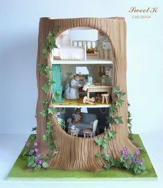 The Tree House- 1st prize and gold award at Cake International in Birmingham. The structure was made of pastillage, and all decorations were made in sugar and modeling paste.