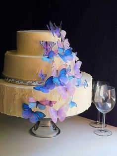 I'm not obsessed with butterflies, but they are fascinating.  These edible butterflies make me want to throw a spring party just to put them on a simple yummy buttercream cake. People would think I was a professional!