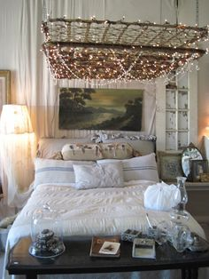 old mattress springs as base for hanging lights. hmmm. pretty cool.