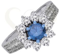 18 KT white gold ring with blue and colorless diamonds.