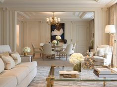 Rooms designed by Pierre-Yves Rochon are illuminated by chandeliers and have classic French furniture, rich fabrics, and reproductions of Renaissance art. Floral arrangements throughout are works of genius.