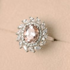 This ring features a 8mm*10mm oval cut morganite and sterling silver finished with rhodium. Customization is available. It is made by hand, and it will take about 7 days to finish the ring after your payment is completed. Main stone: Morganite Morganite weight: Approx 2.10 ct Metal type: sterling silver finished with rhodium Accent stone: cz Customization is available, I also can make it with 14k solid gold (white or yellow or rose) and other accent stone, just feel free to contact me. Any…