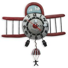 Fly in the clouds with this airplane wall pendulum clock. Features all the numbers in the dial, unique cloud clock hands with parachute jumper pendulum. Comes with AA battery.