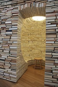 "I want to build a reading nook out of reading material! This is an installation piece at the Whitney Art Works Gallery in Maine by Aaron T. Stephan entitled ""Building Houses/Hiding Under Rocks"" from 2007."