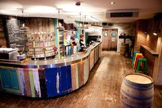 "Recycled wood bar, including doors in ""Beerd"" craft beer bar in Bristol, England. Architect: Simple Simon Design"