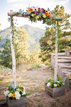 An archway set in flower beds is a wonderfully simple idea for a rustic wedding.