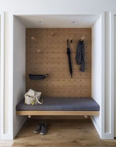 Storage Room In the foyer, the designers turned a closet into a valet area. The bench is upholstered in fabric by Knoll. #apartmentsbrooklynloft