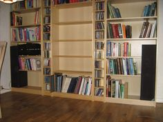 Build your speakers into that bookshelf, it will give the room a new look!