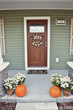 fall porch. DIY Dollar store planters & DIY wreath at lizmarieblog.com