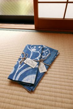 Inspired by the beautiful Japanese Zubaki Flower. This Tenugui is dyed with natural Indigo and the technique that is used is called Rozome (Wax-dying).