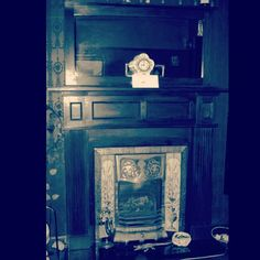 Solid wood fire surround with mirror from a house in