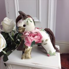 A personal favourite from my Etsy shop https://www.etsy.com/uk/listing/512038008/horse-doorstop-vintage-fabric-doorstop
