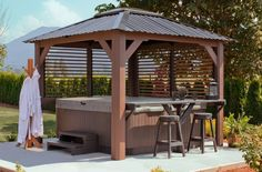 I would love to add a hot tub like this in my yard. It has a bar to put things. Also, it has the gazebo and that would be nice to keep rain or snow off of the hot tub. Hot Tub Pergola, Hot Tub Backyard, Hot Tub Garden, Garden Gazebo, Pergola Patio, Pergola Ideas, Whirlpool Bar, Whirlpool Pergola, Pavilion Design