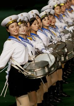Performers at the Arirang Festival (Mass Games) Pyongyang, North Korea. Photo by Eric Lafforgue. Trip To North Korea, Life In North Korea, Military First, Military Women, Military Female, Eric Lafforgue, Mass Games, Cult Of Personality, Workers Party