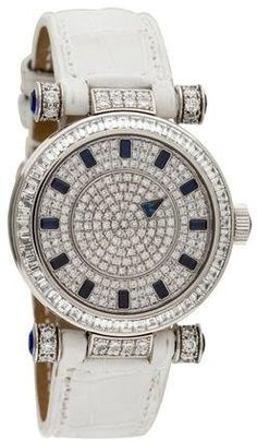 Franck Muller Mystery Watch by Franck Muller  Franck Muller Mystery Watch by Franck Muller  18K white gold 30mm Franck Muller Mystery watch featuring an automatic movement with open exhibition case back and visible platinum rotor diamond bezel and lugs pavé diamond dial with near colorless and very slightly included diamonds white alligator strap and diamond embellished tang buckle closure. Unfortunately due to restrictions this item cannot be shipped internationally.