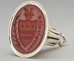 Gold fob seal, with an oval carnelian engraved with Washington's coat of arms, the gem set in a Gold flaring mount with reeded strapwork and small roundels, with a loop for suspension. Antique Interior, Wax Seals, Signet Ring, Coat Of Arms, Carnelian, Tea Cups, Jewelry Watches, Gemstone Rings, Monogram