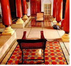 Athangudi Tiles, paprika color tile and columns