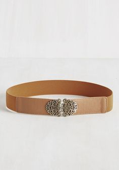 Make an Ornamental Note Belt in Cognac. On the day this brown belt arrives, you set aside time to style its faux-leather accents and gold, filigree buckle with as many looks as you can think up. #brown #modcloth