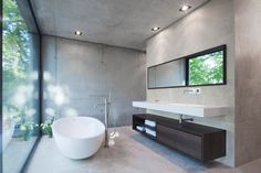 Enjoy the view while you're in the bathroom. \\ #minimalist #bathroom #grey \\ Haus O by: Peter Ruge Architekten \ Potsdam-Mittelmark, Germany