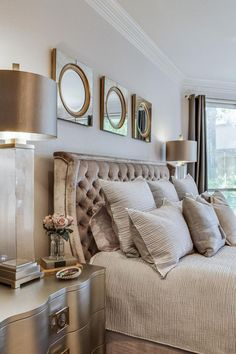 Metallic finishes steal the show in this classy master bedroom. Silver nightstands flank the bed, complementing the crushed velvet headboard, and neutral bedding keeps the space feeling calm.