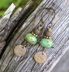 earthy bohemian dangle earrings with czech glass, indo-pacific glass and artisan crafted bronze beads.