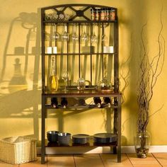 Decorative Bakers Rack and Wine Rack by Southern Enterprises. $188.99. Some assembly may be required. Please see product details.. Decorative Bakers Rack and Wine Rack. An excellent addition to any kitchen, this coffee brown baker's rack not only puts things in a good location, but it also provides storage for those hard to place items. The rectangular metal frame provides a rigid construction while incorporating lovely decorative scrolls on either side. There is a b...