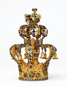 Torah Crown, Austria (ca. 1825; gold, silver, diamonds, emeralds, rubies, amethysts, turquoises). Probably made for a personal Torah scroll. Central to Jewish observance is the Torah, the first five books of the Hebrew Bible. The Torah is written on a scroll and wound on rollers. It is customary to decorate the rollers with a crown, symbolizing the majesty and law of the Torah. © Victoria and Albert Museum, London.