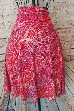 """This is an adorable skirt! Animal Snake Print size XL made by George. It is a similar style and fabric as the popular Lularoe Brand Azure Skirt. Major difference is the sinched sides (photo 4) It is perfect for summer!   Waist: 40""""- 50"""" Length: 26""""  I can bundle ANY of my Items! Just ask! I also offer a 10% off discount for 2+ items bundled. Pretty good deal!   10% is only on listings I bundle for you. Does not apply if you buy 2+ listings individually, so make sure you communi..."""