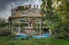 Jungle Ride - Vintage caterpillar ride left behind in an abandoned amusement park.
