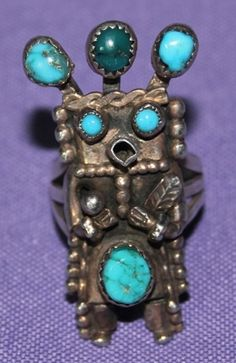 A daring choice of stones in varying shades of blue to blue green turquoise by the incomparable Helen Long !  Triple split shank allows the finger wearing this kachina sculpture to breathe. $485
