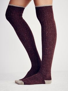 Falling Leaves Over the Knee Sock   Speckled over the knee sock featuring contrast accented on the toe, heel and trim. The perfect pair for tall boots and mini hems.
